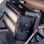 Leimwerk-mit-Duesen-Gluing-unit-with-jet-matrix